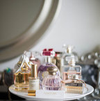 Beauty product/makeup storage hack: Fragrance bottles on a cake stand. SO CUTE